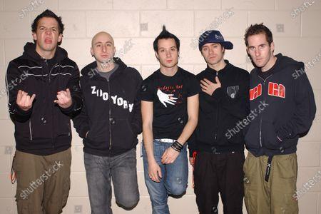 Pierre Bouvier, Chuck Comeau, Jeff Stinco, Sebastien Lefebvre, David Desrosiers of Simple Plan pose backstage