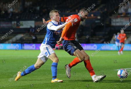 Sonny Bradley of Luton Town  defends the ball from Riley McGree of Birmingham City