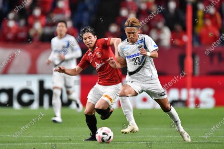 Urawa Reds' Kazuki Nagasawa (L) and Gamba Osaka's Takashi Usami during the 2020 J.LEAGUE J1 soccer match between Urawa Red Diamonds 1-2 Gamba Osaka at Saitama Stadium 2002 in Saitama, Japan.
