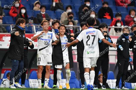 Gamba Osaka's Ryu Takao (27) celebrates after scoring their 2nd goal with Takashi Usami and Shu Kurata during the 2020 J.LEAGUE J1 soccer match between Urawa Red Diamonds 1-2 Gamba Osaka at Saitama Stadium 2002 in Saitama, Japan.