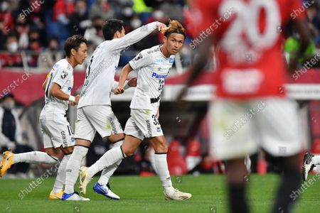 Stock Picture of Gamba Osaka's Takashi Usami (R) celebrates after scoring their 1st goal during the 2020 J.LEAGUE J1 soccer match between Urawa Red Diamonds 1-2 Gamba Osaka at Saitama Stadium 2002 in Saitama, Japan.