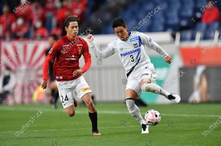 Urawa Reds' Koya Yuruki (L) and Gamba Osaka's Gen Shoji during the 2020 J.LEAGUE J1 soccer match between Urawa Red Diamonds 1-2 Gamba Osaka at Saitama Stadium 2002 in Saitama, Japan.