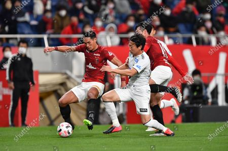 Urawa Reds' Tomoaki Makino (L) and Gamba Osaka's Kazuma Watanabe during the 2020 J.LEAGUE J1 soccer match between Urawa Red Diamonds 1-2 Gamba Osaka at Saitama Stadium 2002 in Saitama, Japan.