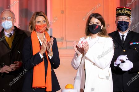 """Marlene Schiappa and Sylvie Tellier. Illumination ceremony in the colors of the International Day for the Elimination of Violence against Women. Lighting of the Hotel de Beauvau in the colors of the """"Orange the World"""" campaign."""