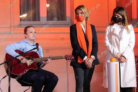 """Eloise Lapaille, Marlene Schiappa and Sylvie Tellier. Illumination ceremony in the colors of the International Day for the Elimination of Violence against Women. Lighting of the Hotel de Beauvau in the colors of the """"Orange the World"""" campaign."""