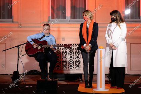 """Stock Picture of Eloise Lapaille, Marlene Schiappa and Sylvie Tellier. Illumination ceremony in the colors of the International Day for the Elimination of Violence against Women. Lighting of the Hotel de Beauvau in the colors of the """"Orange the World"""" campaign."""