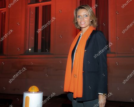 """Sylvie Tellier. Illumination ceremony in the colors of the International Day for the Elimination of Violence against Women. Lighting of the Hotel de Beauvau in the colors of the """"Orange the World"""" campaign."""