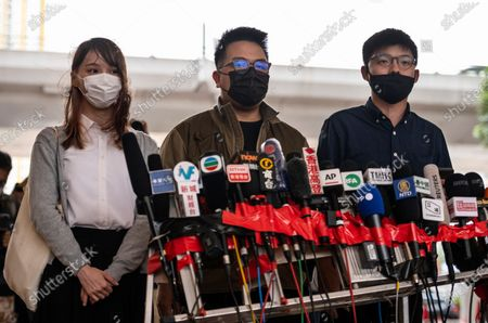 Stock Photo of Agnes Chow (L), Ivan Lam (C), and Joshua Wong (R) talk to the press at the West Kowloon Law Courts building on November 2020 in Hong Kong, China. The pro-democracy activists Joshua Wong, Ivan Lam and Agnes Chow were taken into custody after they pled guilty to inciting and organizing an unauthorized assembly related to last year protest.