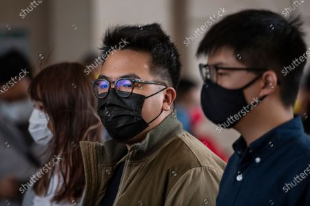 Joshua Wong (R), Ivan Lam (C), and Agnes Chow (L) talk to the press at the West Kowloon Law Courts building on November 2020 in Hong Kong, China. The pro-democracy activists Joshua Wong, Ivan Lam and Agnes Chow were taken into custody after they pled guilty to inciting and organizing an unauthorized assembly related to last year protest.