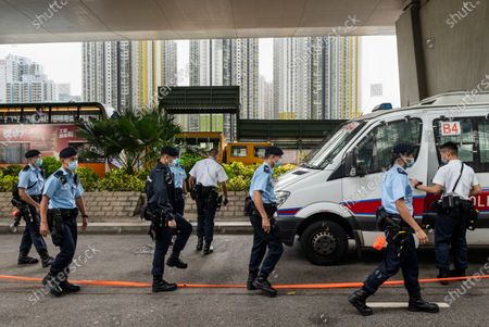 Stock Picture of Police officers leave the West Kowloon Law Courts building premises after they cordon the area as Joshua Wong, Ivan Lam and Agnes Chow were expected to carried away by the Correctional Services vehicle on November 2020 in Hong Kong, China. The pro-democracy activists Joshua Wong, Ivan Lam and Agnes Chow were taken into custody after they pled guilty to inciting and organizing an unauthorized assembly related to last year protest.