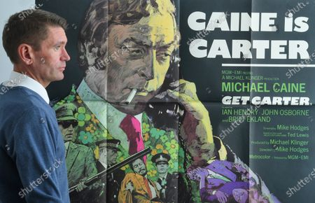 The cult 1971 Michael Caine film Get Carter poster sold for £2,200. Auctioneer Neil Shuttleworth with the poster.   A retired film projectionist has sold hundreds of movie posters he saved from the bin for £34,000.  The unnamed vendor worked for a film company that showed new releases in town and village halls in rural Somerset during the 1970s and '80s.  For every movie he was sent one or two advertising posters to pin up outside the venues.