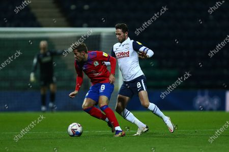 Stock Image of Joe Rothwell of Blackburn Rovers and Alan Browne of Preston North End