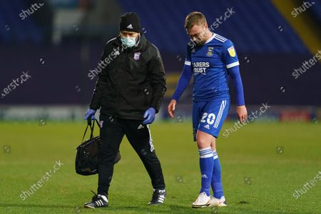 Freddie Sears of Ipswich Town receives medical treatment before leaving the game injured
