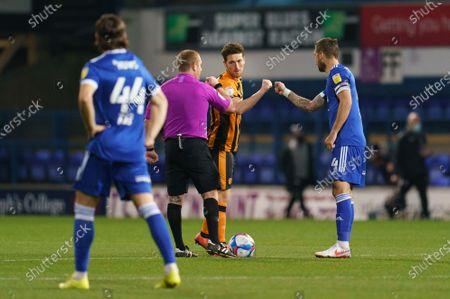 Richie Smallwood of Hull City (6) and Luke Chambers of Ipswich Town (4)