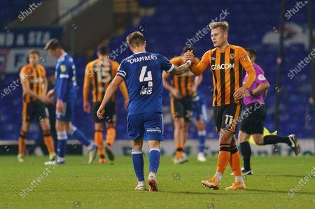 James Scott of Hull City (11) shakes hands with Luke Chambers of Ipswich Town (4)