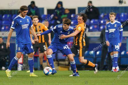 Brett McGavin of Ipswich Town (42) and George Honeyman of Hull City (10)