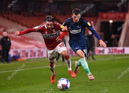 Jason Knight of Derby County tussles with Patrick Roberts of Middlesbrough