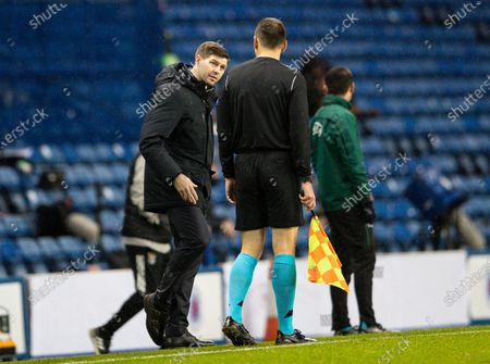Steven Gerrard manager of Rangers reacts towards the fourth official