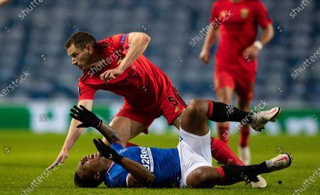 Stock Photo of Jan Vertonghen of SL Benfica fouls Alfredo Morelos of Rangers