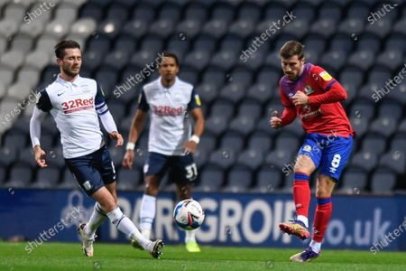Stock Photo of Joe Rothwell #8 of Blackburn Rovers clears the ball under pressure from Alan Browne #8 of Preston North End