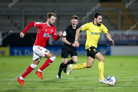 Ryan Edwards #4 of Burton Albion is chased by Andrew Shinnie #12 of Charlton Athletic