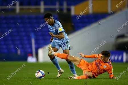 Sam McCallum #21 of Coventry City is tackled by Harry Wilson #23 of Cardiff City