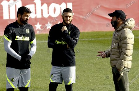 Stock Photo of Atletico Madrid's head coach Diego Simeone (R) wearing a protective face mask gives instruction to his players Diego Costa (L) and Koke (C) during their team's training session at Sports City in Majadahonda, near Madrid, Spain, 24 November 2020. Atletico Madrid will face Lokomotiv Moscow in their UEFA Champions League group A soccer match on 25 November 2020.