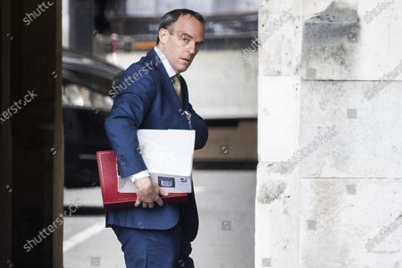 Foreign Secretary Dominic Raab walks in The Houses of Parliament .