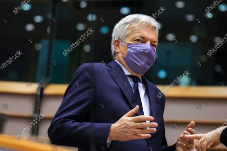 Stock Photo of European Commissioner for Justice Didier Reynders wears a protective face mask as speaks during a plenary session at the European Parliament in Brussels