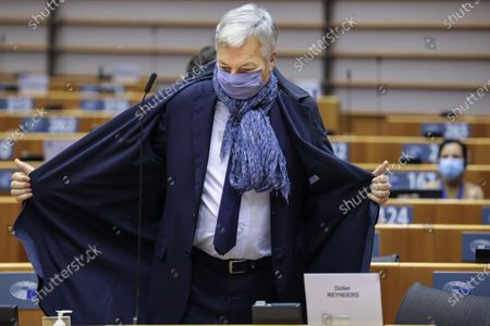 European Commissioner for Justice Didier Reynders wears a protective face mask as he arrives for a plenary session at the European Parliament in Brussels