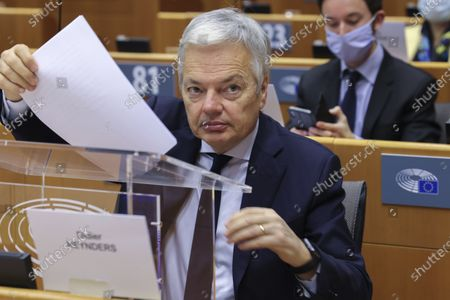 European Commissioner for Justice Didier Reynders prepares to speak during a plenary session at the European Parliament in Brussels