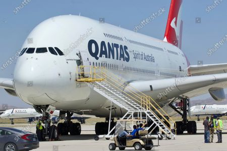 A Qantas Airbus A380 arrives at Southern California Logistics Airport in Victorville, Calif. Qantas Chief Executive Alan Joyce, Australia's largest airline, said that once a virus vaccine becomes widely available, his carrier will likely require passengers use it before they can travel abroad or land in Australia