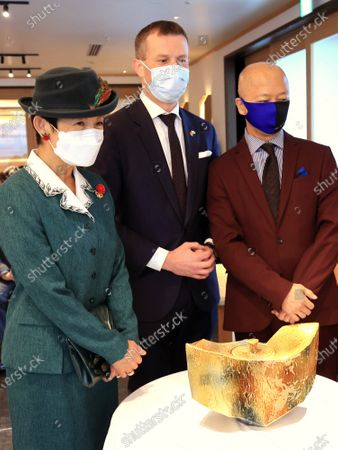 """Stock Image of Japanese Princess Takamado (L) smiles with Hungarian ambassador to Japan Norbert Palanovics (C) and ceramic artist Toshio Ohi (R) at a reception for the 40th anniversary of Lubik's Cube puzzle in Tokyo on Tuesday, November 24, 2020. Japanese artists produced art works for the anniversary of Lubik's Cube """"Lubik's Cube Inspiration Project"""" and the embassy will have auction for charity."""