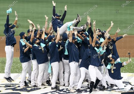 Stock Photo of Members of the NC Dinos celebrate with team manager Lee Dong-wook (up) after winning the 2020 Korean Series title with a 4-2 victory over the Doosan Bears in Game 6 at Gocheok Sky Dome in Seoul, South Korea, 24 November 2020.