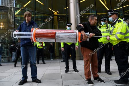 Stock Picture of Anti-vaccine protesters outside the Bill and Melinda Gates Foundation European HQ in Victoria Street.