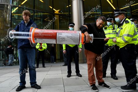 Stock Photo of Anti-vaccine protesters outside the Bill and Melinda Gates Foundation European HQ in Victoria Street.
