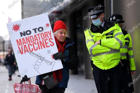 Stock Image of An anti-vaccine protester outside the Bill and Melinda Gates Foundation European HQ in Victoria Street.