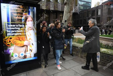 Piers Corbyn (R) lectures his theories of vaccines after protesting against Covid-19 vaccination, outside the headquarters of the Bill and Melinda Gates Foundation in London, Britain, 24 November 2020. Vaccine trials from a number of pharmaceutical companies are proving successful, giving hope at ending restrictions due to the ongoing coronavirus pandemic.
