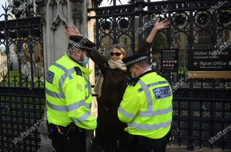 An anti-vax demonstrator talks to police after protesting against Covid-19 vaccination, outside the headquarters of the Bill and Melinda Gates Foundation in London, Britain, 24 November 2020. Vaccine trials from a number of pharmaceutical companies are proving successful, giving hope at ending restrictions due to the ongoing coronavirus pandemic.