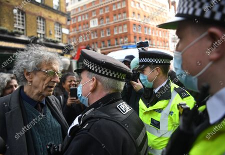 Anti-vax demonstrator Piers Corbyn (L) talks to police while protesting against Covid-19 vaccination, outside the headquarters of the Bill and Melinda Gates Foundation in London, Britain, 24 November 2020. Vaccine trials from a number of pharmaceutical companies are proving successful, giving hope at ending restrictions due to the ongoing coronavirus pandemic.