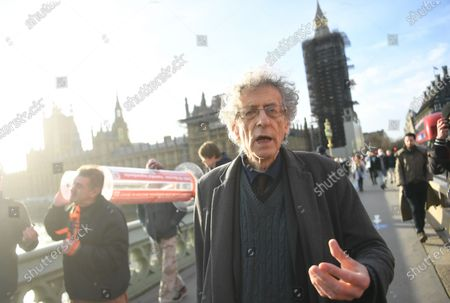 An anti-vax demonstrator Piers Corbyn (R) speaks after protesting against Covid-19 vaccination, outside the headquarters of the Bill and Melinda Gates Foundation in London, Britain, 24 November 2020. Vaccine trials from a number of pharmaceutical companies are proving successful, giving hope at ending restrictions due to the ongoing coronavirus pandemic.