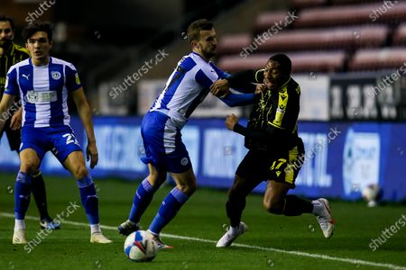 Stock Picture of Ali Koiki of Bristol Rovers is fouled by Tom James of Wigan Athletic