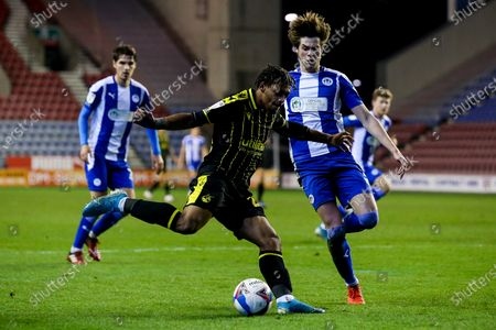 Zain Walker of Bristol Rovers takes on Tom Pearce of Wigan Athletic