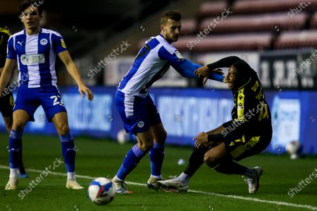 Ali Koiki of Bristol Rovers is fouled by Tom James of Wigan Athletic