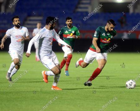 Stock Picture of Al-Ettifaq's player Hassan Al Salis (R) in action against Al-Fateh's Mohammed Al Saeed (C) during the Saudi Professional League soccer match between Al-Ettifaq and Al-Fateh at Prince Mohammed Bin Fahd Stadium, in Dammam, Saudi Arabia, 24 November 2020.