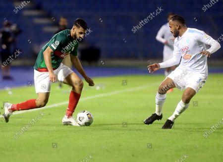 Al-Ettifaq's player Hassan Al Salis (L) in action against Al-Fateh's Mohammed Naji (R) during the Saudi Professional League soccer match between Al-Ettifaq and Al-Fateh at Prince Mohammed Bin Fahd Stadium, in Dammam, Saudi Arabia, 24 November 2020.