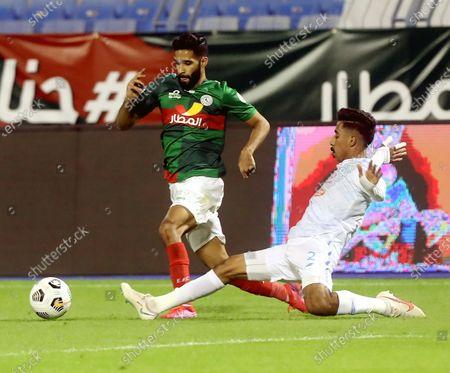 Al-Ettifaq's player Hazzaa Al-Hazzaa (L) in action against Al-Fateh's Nawaf Boushal (R) during the Saudi Professional League soccer match between Al-Ettifaq and Al-Fateh at Prince Mohammed Bin Fahd Stadium, in Dammam, Saudi Arabia, 24 November 2020.