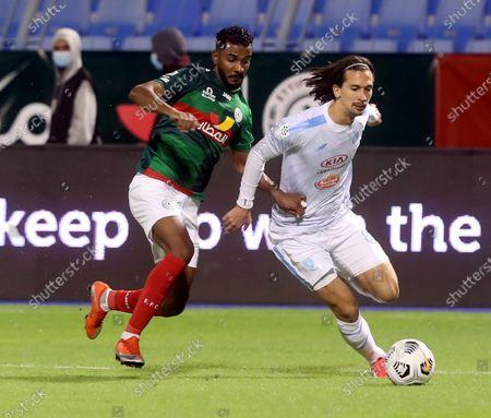 Al-Ettifaq's player Saleh Al Qumayzi (L) in action against Al-Fateh's Gustav Wikheim (R) during the Saudi Professional League soccer match between Al-Ettifaq and Al-Fateh at Prince Mohammed Bin Fahd Stadium, in Dammam, Saudi Arabia, 24 November 2020.