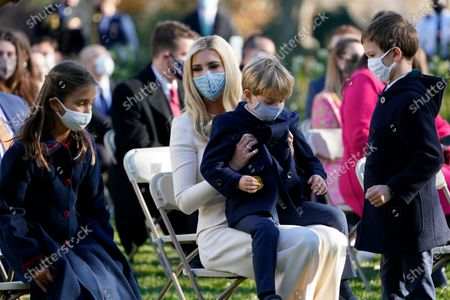 Ivanka Trump, Assistant to the President, sits with her son Theodore Kushner, center, daughter Arabella Kushner, left, and son Joseph Kushner, right, as they wait for President Donald Trump to pardon Corn, the national Thanksgiving turkey, in the Rose Garden of the White House, in Washington