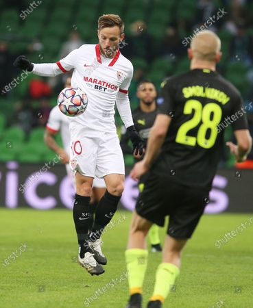 Sevilla's Ivan Rakitic, left, vies for the ball with Krasnodar's Igor Smolnikov during the UEFA Champions League, group E, soccer match, between Krasnodar and Sevilla at the Krasnodar Stadium in Krasnodar, Russia